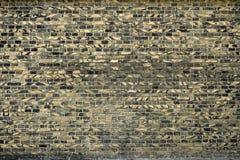 Alte Backsteinmauer für des Hintergrundes, Gelber und Schwarzer Farbe der Beschaffenheit oder Lizenzfreies Stockfoto