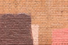 Alte Backsteinmauer gemalt in den verschiedenen Farben Lizenzfreie Stockfotos