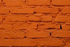 Alte Backsteinmauer gemalt in der orange Farbe Lizenzfreies Stockbild