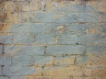 Alte Backsteinmauer gemalter Graffitibeschaffenheitshintergrund Stockfoto