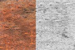 Alte Backsteinmauer halb-gemalt Lizenzfreies Stockbild