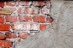 Alte Backsteinmauer mit Beton Lizenzfreie Stockfotos