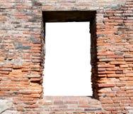 Alte Backsteinmauer mit einem Fenster Stockfotografie
