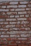 Alte Backsteinmauer mit Gips Lizenzfreies Stockfoto