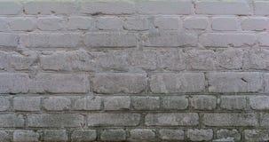 Alte Backsteinmauer mit Gips Stockbild