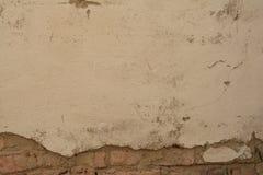 Alte Backsteinmauer mit Gips Lizenzfreie Stockfotos