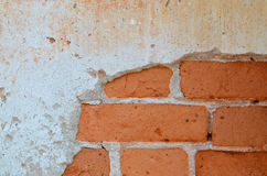 Alte Backsteinmauer mit Gips Lizenzfreies Stockbild