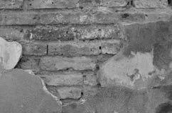 Alte Backsteinmauer mit Gips, Monoton Stockbild