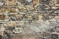 Alte Backsteinmauer mit unterschiedlicher Größe von Steinen, Abschluss herauf Foto Beschaffenheit oder Hintergrund Lizenzfreies Stockbild