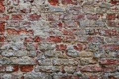 Alte Backsteinmauer mit Weiß und Hintergrund der roten Backsteine Lizenzfreies Stockbild