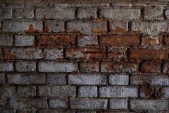 Alte Backsteinmauer mit Weiß und Hintergrund der roten Backsteine Weinlesebacksteinmauerbeschaffenheit Stockbild
