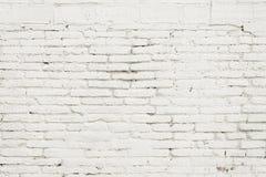 Alte Backsteinmauer mit weißer Farbenhintergrundbeschaffenheit Stockfotos