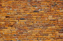 Alte Backsteinmauer, roter Steinziegelstein, die alte Wand Stockbilder