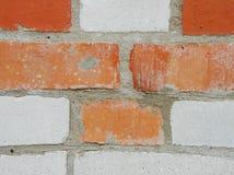 Alte Backsteinmauer roter und weißer Ziegelstein Stockbild