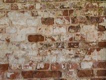 Alte Backsteinmauer Schäbige Oberfläche der alten Maurerarbeit Lizenzfreies Stockfoto