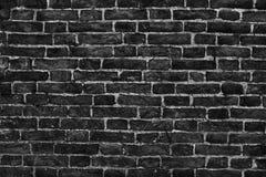 Alte Backsteinmauer, schwarze Hintergrundbeschaffenheit Stockfotografie