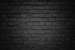 Alte Backsteinmauer, schwarze Hintergrundbeschaffenheit Lizenzfreie Stockbilder