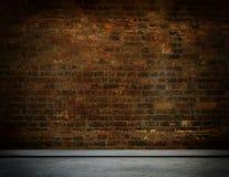 Alte Backsteinmauer und konkreter Boden Stockfotos