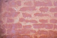 Alte Backsteinmauerbeschaffenheit des rosa Hintergrundes Lizenzfreies Stockfoto