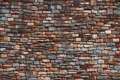 Alte Backsteinmauerbeschaffenheit in einem Hintergrund Stockfotografie