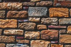 Alte Backsteinmauerbeschaffenheit in einem Hintergrund Lizenzfreie Stockbilder
