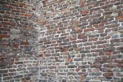 Alte Backsteinmauerecke Stockbild