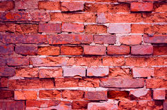 Alte Backsteinmauerorange des Hintergrundes Stockfotografie