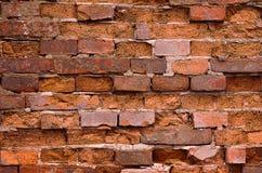 Alte Backsteinmauerorange des Hintergrundes Stockfoto