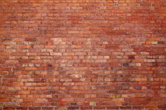 Old brick wall with red building blocks royalty free stock images