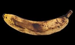 Alte Banane auf einem schwarzen Hintergrund Lizenzfreie Stockfotos