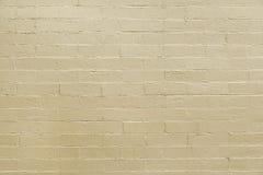Alte beige Backsteinmauerhintergrundbeschaffenheit Lizenzfreie Stockfotografie