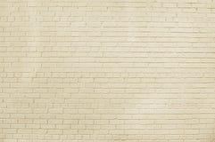 Alte beige Backsteinmauerhintergrundbeschaffenheit Lizenzfreies Stockbild