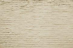 Alte beige Backsteinmauerhintergrundbeschaffenheit Lizenzfreie Stockfotos