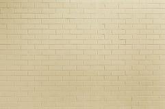 Alte beige Backsteinmauerhintergrundbeschaffenheit Stockfotografie