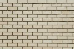 Alte beige Backsteinmauerhintergrundbeschaffenheit Lizenzfreie Stockbilder