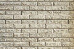 Alte beige Backsteinmauerhintergrundbeschaffenheit Stockfoto