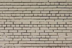 Alte beige Backsteinmauerhintergrundbeschaffenheit Lizenzfreies Stockfoto