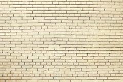 Alte beige Backsteinmauerhintergrundbeschaffenheit Stockfotos