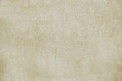 Alte beige Betonmauerhintergrundbeschaffenheit Stockfotos