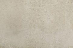 Alte beige Betonmauerhintergrundbeschaffenheit Lizenzfreie Stockbilder