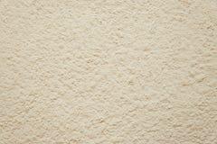 Alte beige Betonmauerhintergrundbeschaffenheit Stockfotografie