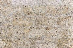 Alte beige Granitsteinwand-Hintergrundbeschaffenheit Lizenzfreie Stockfotos