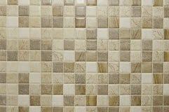 Alte beige Mosaiksteinwand-Hintergrundbeschaffenheit Lizenzfreies Stockfoto