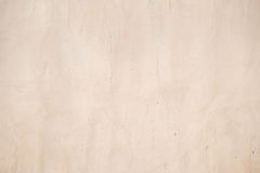 Alte beige Schmutzbetonmauer Stockfotografie