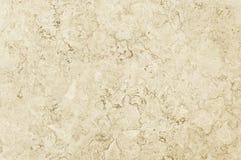 Alte beige Steingranitwand-Hintergrundbeschaffenheit Lizenzfreies Stockfoto