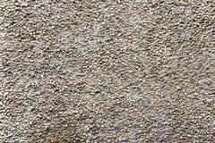 Alte beige Steinwand-Hintergrundbeschaffenheit Lizenzfreies Stockbild