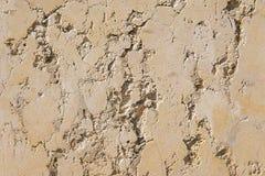 Alte beige Steinwand-Hintergrundbeschaffenheit Lizenzfreie Stockfotografie