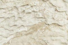 Alte beige Steinwand-Hintergrundbeschaffenheit Stockbild