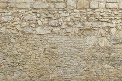 Alte beige Steinwand-Hintergrundbeschaffenheit Stockfotografie