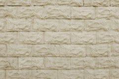 Alte beige Steinwand-Hintergrundbeschaffenheit Lizenzfreie Stockbilder